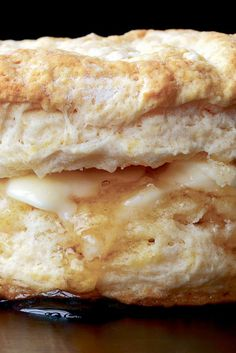 NYT Cooking: Biscuits are what take us into the kitchen today to cook: fat, flaky mounds of quick bread, golden brown, with a significant crumb. Composed of flour, baking powder, fat and a liquid, then baked in a hot oven, they are an excellent sop for sorghum syrup, molasses or honey. They are marvelous layered with country ham or smothered in white sausage gravy, with eggs, with grits. Biscuits are easy t...