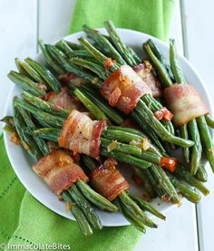 Green Bean Bacon Bundles. Beans toss with garlic and tomatoes, then wrapped in bacon and roasted until Fragrant – Hard to say no.