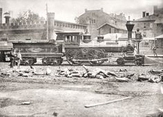 1870 Nashville, Chattanooga & St. Louis Railroad locomotive at the passenger depot, looking east. The prominent building in center background is believed to be the Nashville, TN Female Academy on the north side of Church St.