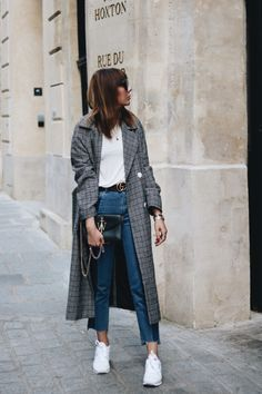 Nicole Ballardini from Amsterdam - style blogger with simple outfits. Here, wearing a check coat, mom jeans and sneakers. Click the image to read more about the Dutch fashion influencer.
