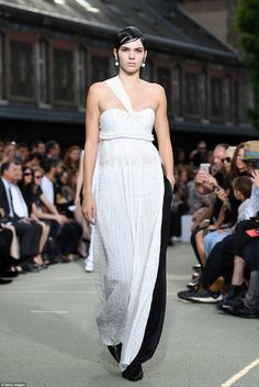 Ruling the runway: Kendall looked regal in the two-tone gown, which effortlessly hugged her lean curves thanks to a billowing skirt and a tight bodice with a cinched-in waist
