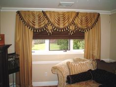 board mounted swags over a roman shade