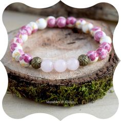 LOVE // Rose Quartz Bracelet - Beaded Bracelet - Stretch Bracelet from $27.00 Ordering is easy. Just copy paste this link: http://ift.tt/2eCPzCW This feminine bracelet will unleash the power of love when you wear it. The painted roses on the ceramic beads and Rose Quartz are the perfect symbol for love. ROSE QUARTZ Associations: All Types of Love Compassion Self Esteem Chakras: Heart Higher Heart Zodiac: Taurus Libra #etsymumbles #product #braceletforsale #smallbiz #instadaily #instashop…