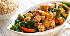 Peppery cubes of tofu top steam-fried vegetables that have the lightest of garlic sauces in this low-fat, vegan Thai tofu dish.