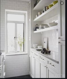 May be these type of shelves on the wall with no cupboards.... clean block. No under lighting.