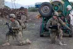 U.S. Army Pfc. Jonathan Nunez (left) and U.S. Army Pfc. Joseph Berry (right), both cannon crewmembers assigned to 2nd Battalion, 377th Parachute Field Artillery Regiment, Task Force 4-25, provide security during a presence patrol Loy Murghoz, Khowst Province, Afghanistan on June 8, 2012. U.S. Army photo by Sgt. Kimberly Trumbull