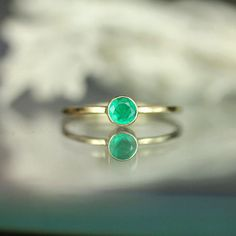 A vibrant drop of green…this little emerald packs a lot of sparkle! Sweet and tart at the same time. Super fun and unique. This ring is completely