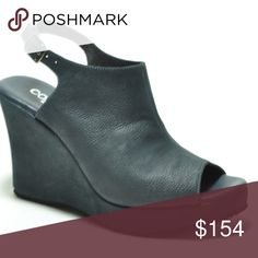 Cordani Wellesley Wedge Sandal in Midnight Blue Cordani comfort in the platform wedge we love.   - 3 3/4 in heel height; 1 inch platform height - peep toe - leather lining - adjustable metal buckle - padded footbed - rubber sole  - made in the USA Cordani Shoes Platforms