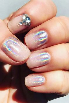 IRIDESCENT OMBRÉ: Our obsession with all things unicorn continues with a (slightly) subtler take on hologram nails.