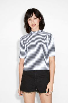 Wide-cut with a low turtleneck collar, this top is heavy on the style n' ease.