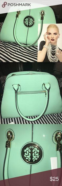 Mint Green Handbag❤️❤️ This Patent Leather Mint green hand bag is sure to make a statement!! It has only been worn once and is like brand new. It has a gold emblem on the front with multiple compartments on the inside. It has a zipper pocket in the back of the purse! Love the look! Make this Handbag yours today. & Other Stories Bags Totes