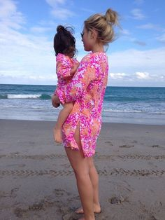 Mother and daughter matching swimsuit cover-ups. Periwinkle Place shopping center Sanibel Island, Florida.