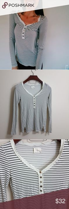 Anthropologie | stripe t.la Henley top | xs In excellent condition!  Beautiful Anthropologie top from t.la. black and cream color. Long and loose fit. Used item: pictures show any signs of wear. Bundle up! Offers always welcome:) Anthropologie Tops