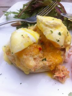 Crab Cake Eggs Benedict.  Two of his favorites but together? Curious!