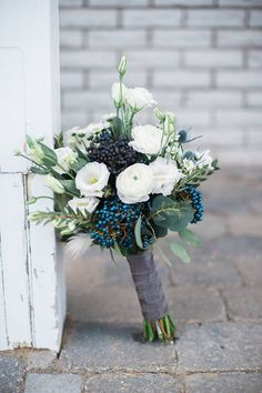 Wedding bouquet of Viburnum berries, Lysianthus, Ranunculus and Thistle. Tracey Jazmin, Photographer at National Arts Centre/Centre