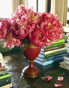Stack art, design, gardening, travel books — whatever you collect — on a table. Books are my favorite accessory because they're so personal — they reflect your interests. —Joe Nye   - HouseBeautiful.com