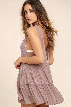 Love at first sight starts and ends with the Free People Look Of Love Mauve Lace Slip! Lightweight and gauzy woven fabric forms this sexy little slip with a plunging neck and back trimmed with lace. Tiered mini skirt has a flirty mini length and even more lace.
