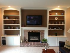 Fireplace- do you have to have the big black glass enclosure? Bookshelves Around Fireplace, Built In Around Fireplace, Basement Fireplace, Fireplace Built Ins, Fireplace Remodel, Living Room With Fireplace, Fireplace Surrounds, Fireplace Design, Fireplace Refacing