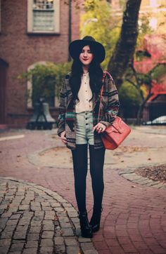 Jacket and high-waisted denim shorts with black tights.