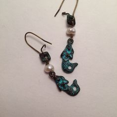A personal favorite from my Etsy shop https://www.etsy.com/listing/478245116/siren-song-mermaid-earrings-greek-patina