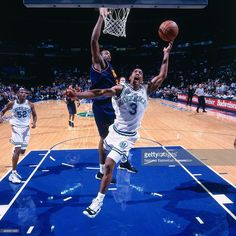 Kevin Ollie #3 of the Dallas Mavericks drives to the basket on January 1, 1998 in Dallas, Texas.