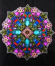 Jules Cote' (18+ division) from Floral Mandalas Stained Glass Coloring Book: http://store.doverpublications.com/0486483126.html