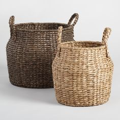 Handwoven in the Philippines from sturdy water hyacinth, our Arielle baskets feature big braided handles and stunning jar-inspired silhouettes. Choose the small basket in natural or large in espresso to make a statement in any space.