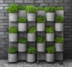 The Garden Anywhere Vertical Garden System Set is a new line of Fiber Cement Planters that are 25% lighter than traditional cast stone products. This unique planter system is a great way to add life and color to that empty wall or fence in your outdoor living space. Composed of Eco-friendly material that is 99% biodegradable materials including cement and jute fiber that is frost and UV resistant. Designed to last a lifetime with proper care. Each piece weathers naturally outdoors.