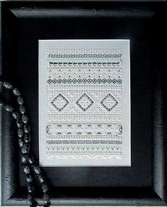 Terri has created an interesting band sampler with Whitework and Blackwork stitches.