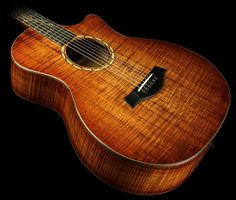 My dream guitar! Hawaiian Koa body with a bone and ebony bridge, mahogany neck, ebony fret board, and the most intricate inlays I've ever seen!