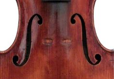 A very fine Cremonese Italian violin in a wonderful state of preservation, no cracks. The instrument still bears the maker's undisturbed original label, dated 1727. This label apparently bears a highly unusual printing error, which is clearly visible in a photograph of it, that is NOT at all visible when examined in person. Here are some very interesting surface features revealed through a detailed examination of the corpus, under very powerful magnification: The table is inscribed '...