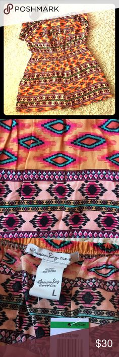 """American Rag Western Boho Aztec Romper NWT When it has a color described as """"Peach Cobbler Combo"""", you know it'll be sure to draw attention. The bright, vivid colors flow through an intricate design pattern. Perfect for warmer weather, a festival, concert, beach day, shopping or a picnic! American Rag Pants Jumpsuits & Rompers"""
