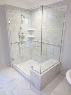 Great Idea for a shower re-do if you have gold framed showers with outdated fixtures and tiles.  This is luxurious!