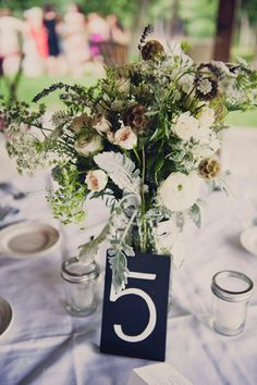 rustic outdoor centerpiece // photo by Khaki Bedford // view more: http://ruffledblog.com/khaki-bedford-jeff-susan-bl/