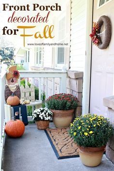 Small Front Porch Decorated For Fall... a cute litte white bench, pumpkins, large containers of flowers, small basket of flowers..... so nice.