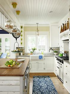 How cute are those pendants filled with wine corks? Love the wood planks on the side of the island.
