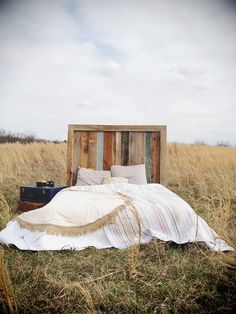 Sleep tight with a rustic barn wood headboard.