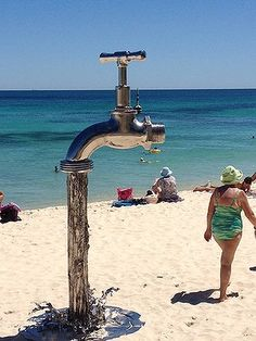 I chose this because I think its very creative to make the shower at the beach with a huge faucet. Its it personality.