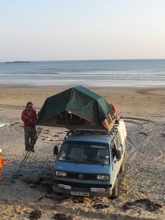 Beach camping in roof tent on a VW Syncro
