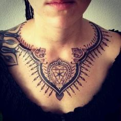 Symbolic necklace chest tattoo