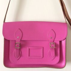 """CAMBRIDGE Large Satchel pink leather 13"""" model This is an authentic CAMBRIDGE pink leather  satchel in great condition. Gently used and kind of breathtaking. There are a few marks on top of the bag that are slightly creased from opening and closing. This can be a shoulder or crossbody bag approx 13x9. ✅ LIKE for a jump on any price drops, but this is pretty firm and a great deal. Cambridge Satchel Bags Crossbody Bags"""
