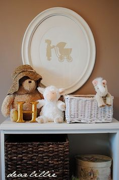 love the silhouette of the little girl and the baby carriage.  would look great in Abby's nursery!