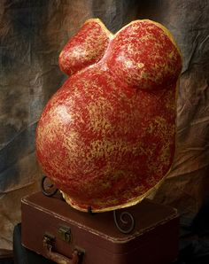 Red and gold painted pregnancy torso casting