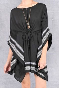 This gorgeous tunic is super flattering, and can be worn as a dress with shorts under. - Ties in the front for a cinched torso. - Black with a double white border. - Long enough to wear as either a dr