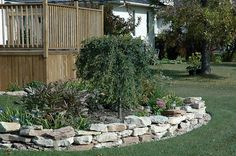 Fire Pit With Pea Gravel And Irregular Flagstone Surround