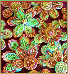 Indian Gems in Royal Icing    I love henna design and these are some gumpaste pieces decorated with royal icing in bright colour tones and lustre gold paint. I'll be using them on some miniture cakes this week. I enhanced the colours to give more vibrance to the photo. They have a bit of an indian influence to them. Hope to post the cake pics soon =)
