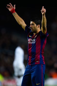 Luis Suarez of FC Barcelona reacts during the UEFA Champions League group F match between FC Barcelona and Paris Saint-Germanin FC at Camp Nou Stadium on December 10, 2014 in Barcelona, Catalonia.