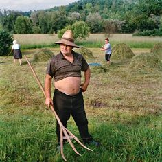 Sixty-three-year-old Mihai Țiplea has the help of his neighbors in Ferești to turn and dry the hay in his field. Work is shared, but each patch of meadow is individually owned and its boundaries carefully marked. Hayforks, made of hazelwood, the tines often polished by years of use, are handed down as heirlooms. Transylvania; Photograph by Rena Effendi, National Geographic