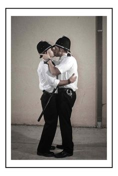 Iconic Banksy Images Recreated in Real Life - Kissing Coppers. Photo credit: Nick Stern