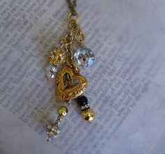 Hey, I found this really awesome Etsy listing at https://www.etsy.com/ca/listing/260367850/charming-necklace-pendant-with-upcycled
